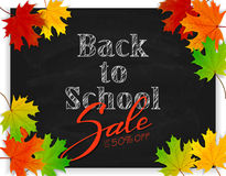 Lettering Back to School and Sale on black chalkboard with maple Stock Images