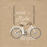 Lettering and bicycles. The composition of the bicycle and phrases from the song. The phrase is composed of different types of letters. background of kraft Royalty Free Stock Photography