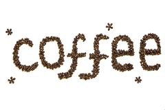 Lettering `Coffee` made of roasted coffee beans isolated on a white background. Word `Coffee` made of roasted coffee beans isolated on a white background Royalty Free Stock Image