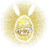Lettering Easter egg hunt on white silhouette on rabbit or egg and gold glitter background. Vector greeting card Stock Images