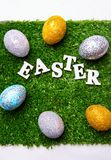 Lettering for Easter with eggs. On grass royalty free stock photo