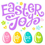 Lettering Easter joy text and eggs Royalty Free Stock Photo