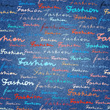 Lettering of Fashion on a jeans denim fabric texture. Stock Photo