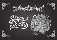 Lettering give thanks with turkey on chalkboard. Stock Photos