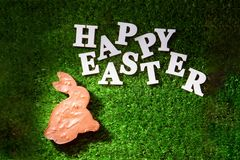 Lettering Happy Easter, laid out on the grass. Lettering Happy Easter with chocolate bunny, laid out on the grass stock photos
