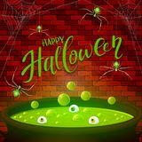 Brick wall and Halloween cauldron with green potion and spiders Royalty Free Stock Images