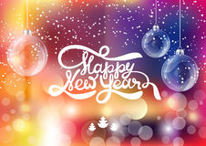 Lettering Happy New year on blur bokeh background. Shine light texture. Glass xmas balls Royalty Free Stock Images