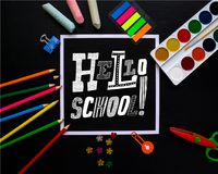 Lettering Hello, School on blackboard. Trendy concept. royalty free stock image
