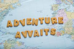 Lettering inspiring Let`s travel on map background. Preparing to journey. Lettering inspiring Let`s travel on map background. Preparing to journey royalty free stock image