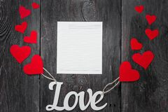 White letters Love with ropes and with red hearts, like balloons. space for text on a white sheet of paper.