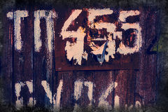Lettering and numbers. On an old wooden surface Royalty Free Stock Images