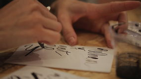 Lettering pen on paper - the creation of the order stock video footage