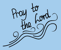 Lettering Pray to the Lord on a blue background Royalty Free Stock Photo
