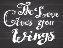 Lettering quote love gives you wings. Hand drawn sketch typographic design motivational romanctic sign, Vector Illustration Stock Photos