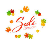 Lettering Sale with colored autumn leaves Stock Photos