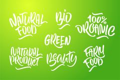 Lettering set for natural products in green colors. Handwritten. Logo Natural food, 100% organic, farm food, Bio, natural product, green, Beauty. Vector text Royalty Free Stock Photos