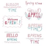 Lettering spring blossom typography inscriptions set. Lettering spring inscriptions set welcome spring hello April blossom time plants separators Stock Photography