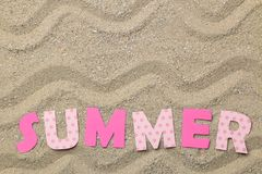 Lettering summer of paper pink letters on sea sand. Summer. relaxation. vacation. top view royalty free stock photography