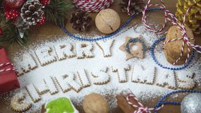 LETTERING TEXT MERRY CHRISTMAS FROM OATS COOKIES Stock Photo