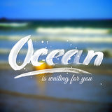 Lettering typography design on blurred ocean Stock Image