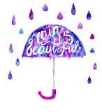 Lettering on umbrella Rain is beautiful Stock Images