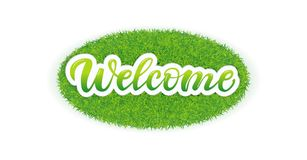 Lettering Welcome on the grass. Welcome lettering. Handwritten modern calligraphy, brush painted letters isolated on the grass stock illustration