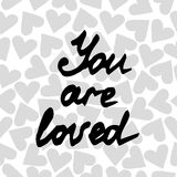 Lettering You are loved on the background with heart Royalty Free Stock Photo