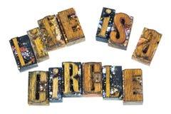 Letterpress życie jest okrąg motywaci wiadomością zdjęcia stock