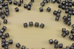 letterpress ανασκόπησης grunge τυχαία λέξη τύπων αγάπης Στοκ Εικόνες