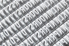 Letterpress background conforming a diagonal pattern. Black and white Royalty Free Stock Image