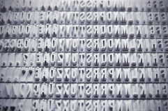 Letterpress background conforming a pattern. Black and white Stock Photography