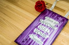 Never let anyone dull your sparkle-phrase. Letterpress, concept, business, sign, type, word, wood, typography, vintage, text, font, illustration, white, isolated stock photography