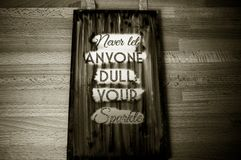 Never let anyone dull your sparkle-phrase. Letterpress, concept, business, sign, type, word, wood, typography, vintage, text, font, illustration, white, isolated royalty free stock photos