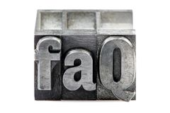 Letterpress FAQ. The phrase FAQ in old letterpress printing blocks isolated on a white background stock photos