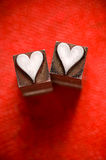 Letterpress Hearts. Image of vintage Letterpress Heart characters on a red texture background, narrow focus stock photography