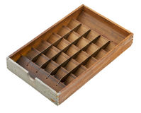 Letterpress matrix sort box. Vintage letterpress matrix sort box, wood with metal dividers and bins, isolated on white - sorting or classifying concept Stock Images