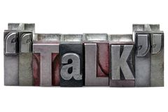 Letterpress Talk. The word Talk in old letterpress printing blocks isolated on a white background Stock Image
