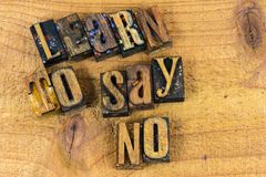 Learn to say no message letterpress. Letterpress type learn to say no message inspiration concept wood letters background Royalty Free Stock Photo