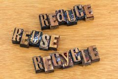 Reduce reuse recycle activism message. Letterpress wood block letters reduce reuse recycle waste cause message motivational Stock Image