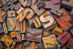 Letterpress wood type blocks background. Alphabet abstract - background of random letterpress wood type printing blocks, mixed fonts, top view Stock Image