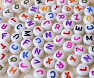 Letters. Small Colorful letters on different white shapes Stock Photo