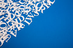Letters. Background of white letters on blue paper Stock Image
