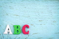Letters ABC on light blue wooden background Stock Photography