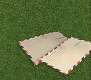 Letters air mail i on grass Stock Photography