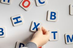 The letters of the alphabet. Against the background of the white school board. stock photography