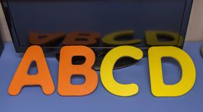 Letters of the alphabet a b c d on table with-reflection-2. Letters of the alphabet a b c d on table with-reflection Royalty Free Stock Photo