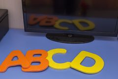 Letters of the alphabet a b c d on table with reflection. Letters of the alphabet a b c d on table with Stock Image