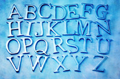 Letters Alphabet. Metal letters of the alphabet with a blue tone royalty free stock image