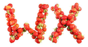 Letters alphabet of red ripe strawberries. Red strawberries isolated on white background. English alphabet Royalty Free Stock Image