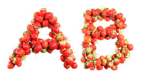 Letters alphabet of red ripe strawberries. Red strawberries isolated on white background. English alphabet Royalty Free Stock Photography